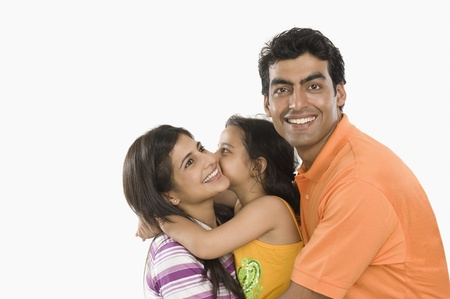 indian subcontinent ethnicity: Close-up of a family smiling