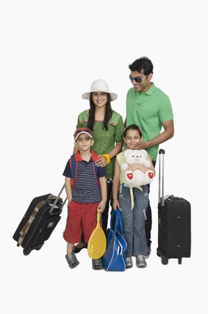 Portrait of a family going for vacations Stock Photo - 10124202