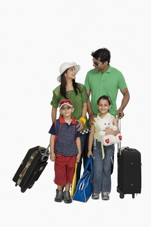 indian subcontinent ethnicity: Family going for vacations and smiling LANG_EVOIMAGES