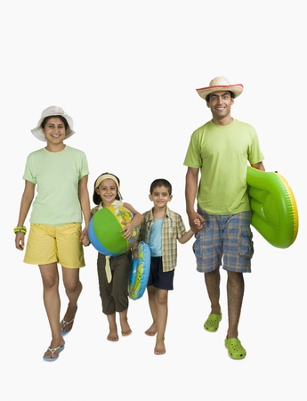 indian subcontinent ethnicity: Portrait of a happy family enjoying on vacations