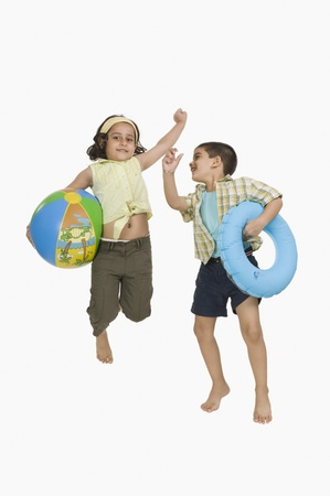 Boy and a girl playing on vacations Stock Photo - 10123910
