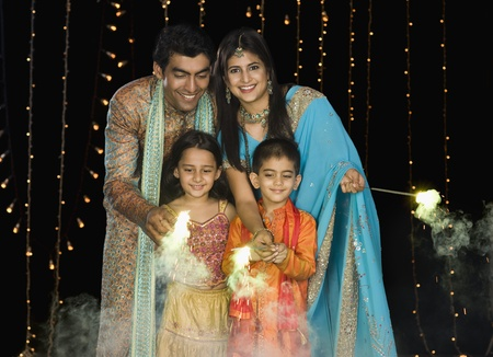 indian subcontinent ethnicity: Family celebrating Diwali festival