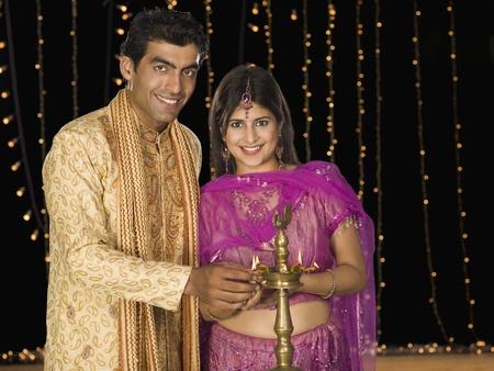 Couple lighting oil lamp on Diwali festival Stock Photo