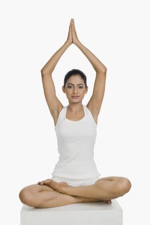 Woman practicing yoga Stock Photo - 10123896
