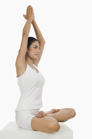 Side profile of a woman practicing yoga Stock Photo - 10125932