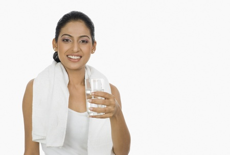 Woman holding a glass of water Stock Photo - 10123958