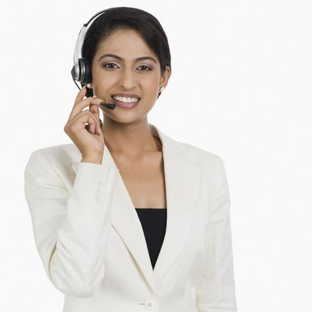 customer service representative: Close-up of a female customer service representative