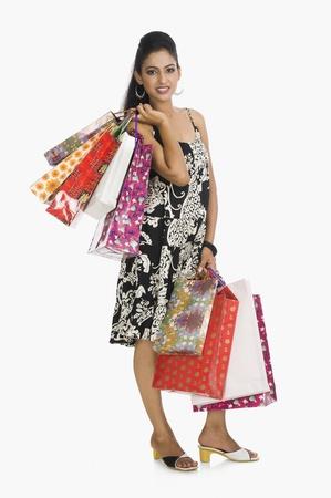 Woman carrying shopping bags Stock Photo - 10125344