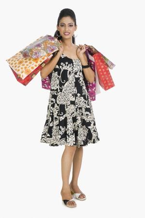 Woman carrying shopping bags Stock Photo - 10124401