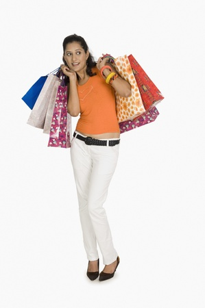 Woman carrying shopping bags and looking afraid Stock Photo - 10124082