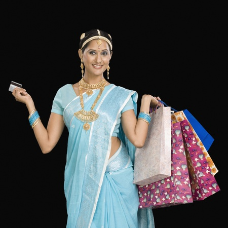 Portrait of a woman carrying shopping bags and a credit card Stock Photo - 10169315