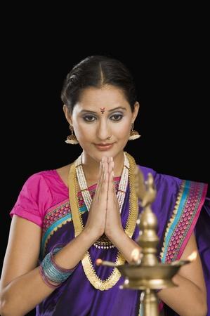 Close-up of a woman praying Foto de archivo