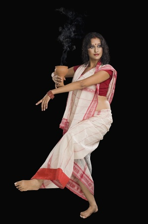 Bengali woman performing ritual dance Stock Photo