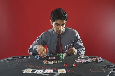 Portrait of a man gambling in a casino Stock Photo - 10169302