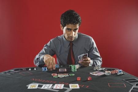 Portrait of a man gambling in a casino Stock Photo - 10169302