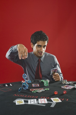 Portrait of a man gambling in a casino Stock Photo - 10166492