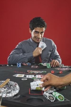 Portrait of a man gambling in a casino Stock Photo - 10169198