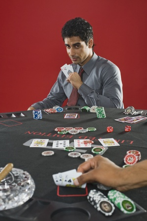 Portrait of a man gambling in a casino Stock Photo - 10166473