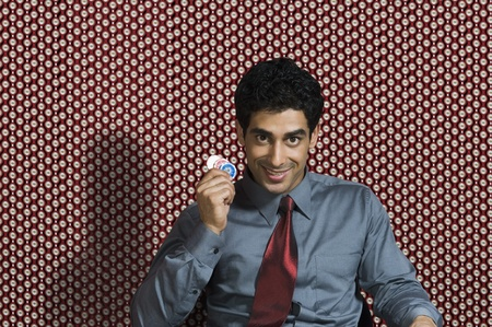 Portrait of a man holding gambling chips Stock Photo - 10166699