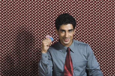 Portrait of a man holding gambling chips Stock Photo - 10166698