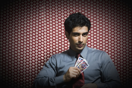 Portrait of a man holding three aces Stock Photo - 10166639