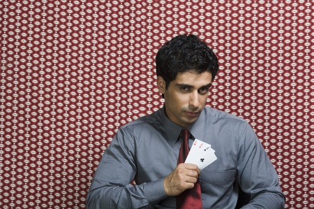 Portrait of a man holding three aces Stock Photo - 10169042