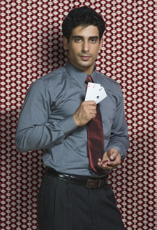 Man holding three aces and gambling chips Stock Photo - 10169043