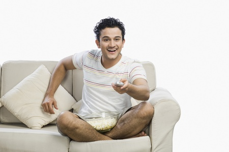 couch potato: Man watching television