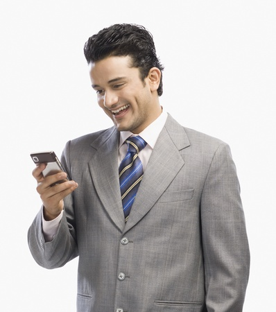 clipping  messaging: Businessman using a mobile phone