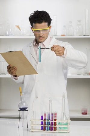Scientist experimenting in a laboratory Stock Photo - 10124617