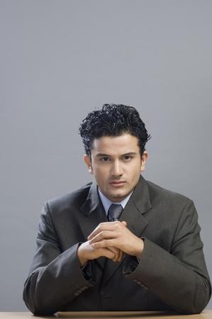 front desk: Portrait of a businessman looking serious LANG_EVOIMAGES