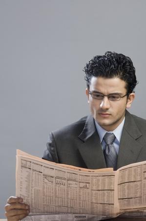 financial newspaper: Businessman reading a financial newspaper