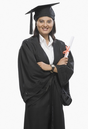 Woman holding a diploma in graduation gown