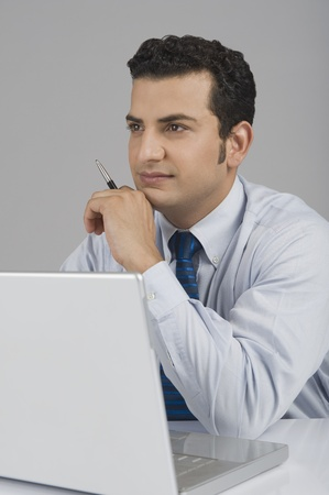 Businessman in front of a laptop Stock Photo - 10124807