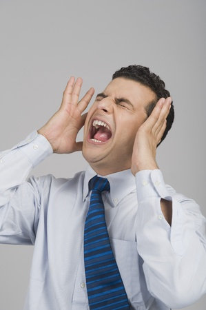 Businessman shouting with eye closed Stock fotó