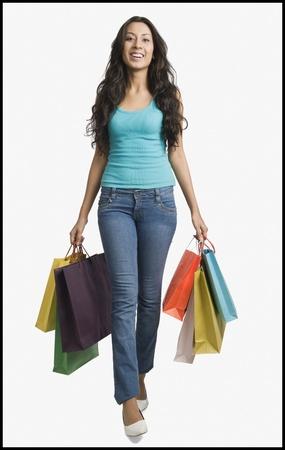 Woman carrying shopping bags Stock Photo - 10124613