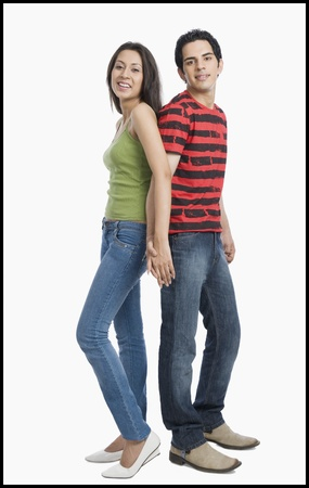 Couple standing back to back with holding hands Stock Photo - 10125570