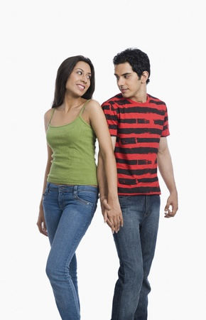 Couple looking at each other with holding hands Stock Photo - 10125200