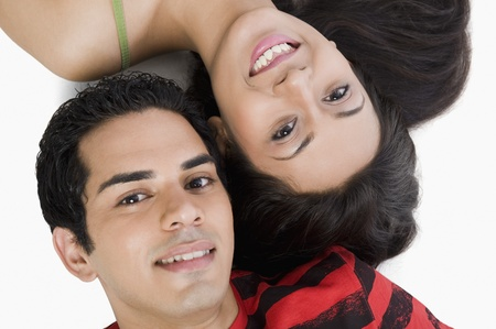 High angle view of a couple lying on the floor and smiling