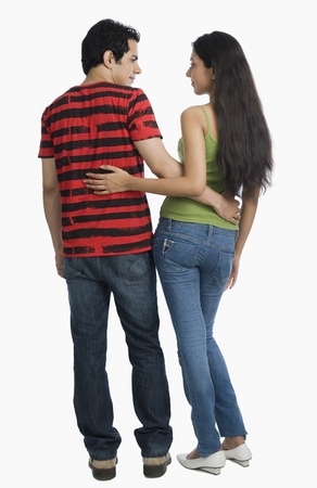 Rear view of a couple standing with arm around Stock Photo - 10125151