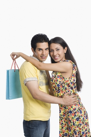 retail therapy: Couple standing with arm around