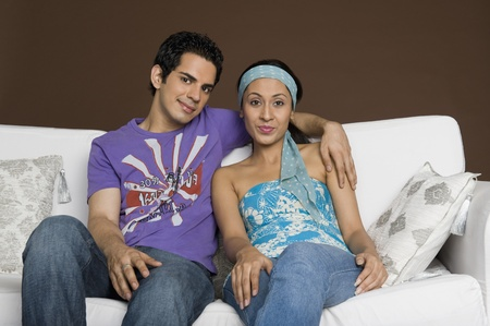couple on couch: Portrait of a couple smiling