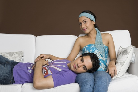 couple on couch: Couple relaxing on a couch