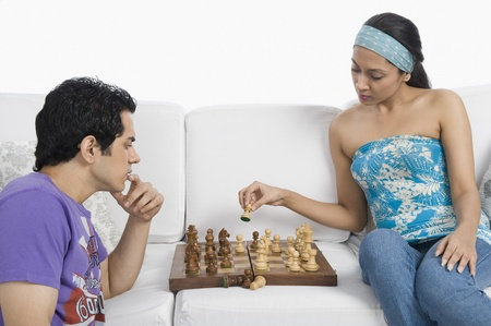 chess board: Couple playing chess