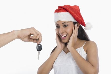 Woman surprised to see car key as a Christmas present Stock Photo - 10124236
