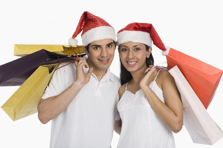 holiday spending: Couple carrying shopping bags