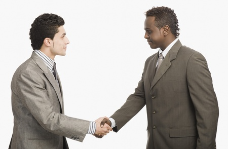 Two businessmen shaking hands Stock Photo - 10166282