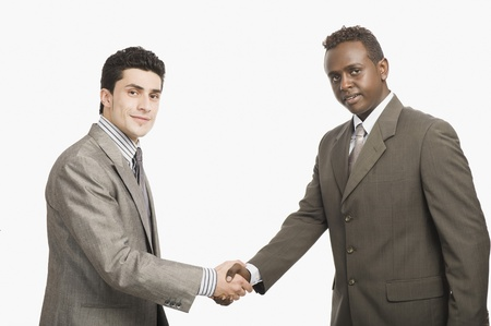 shaking out: Two businessmen shaking hands