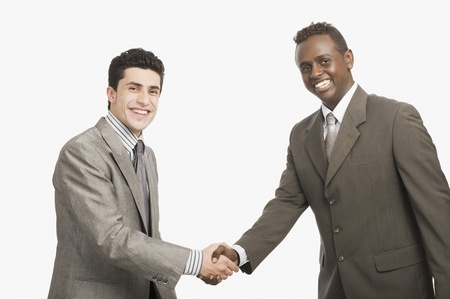 congratulating: Two businessmen shaking hands