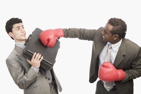 defending: Businessman defending himself from the punch of his colleague